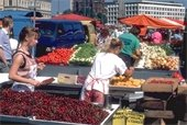 Photo of a farmers market with produce