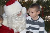Santa visits with children at the Youth Activity Park on Saturday,  Dec. 3.