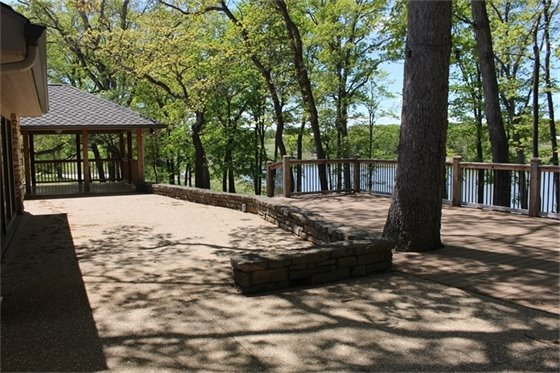Covered patio and deck overlooking 13-acre lake come with Broemmelsiek Park Meeting Facility reservation.