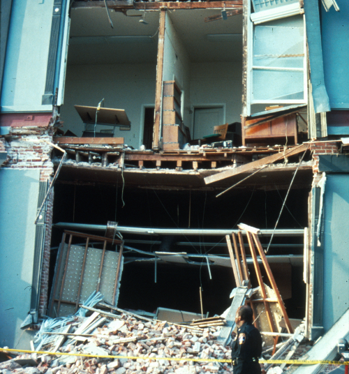 Interior walls remained intact. Exterior wall failed dumping debris around the building exterior.