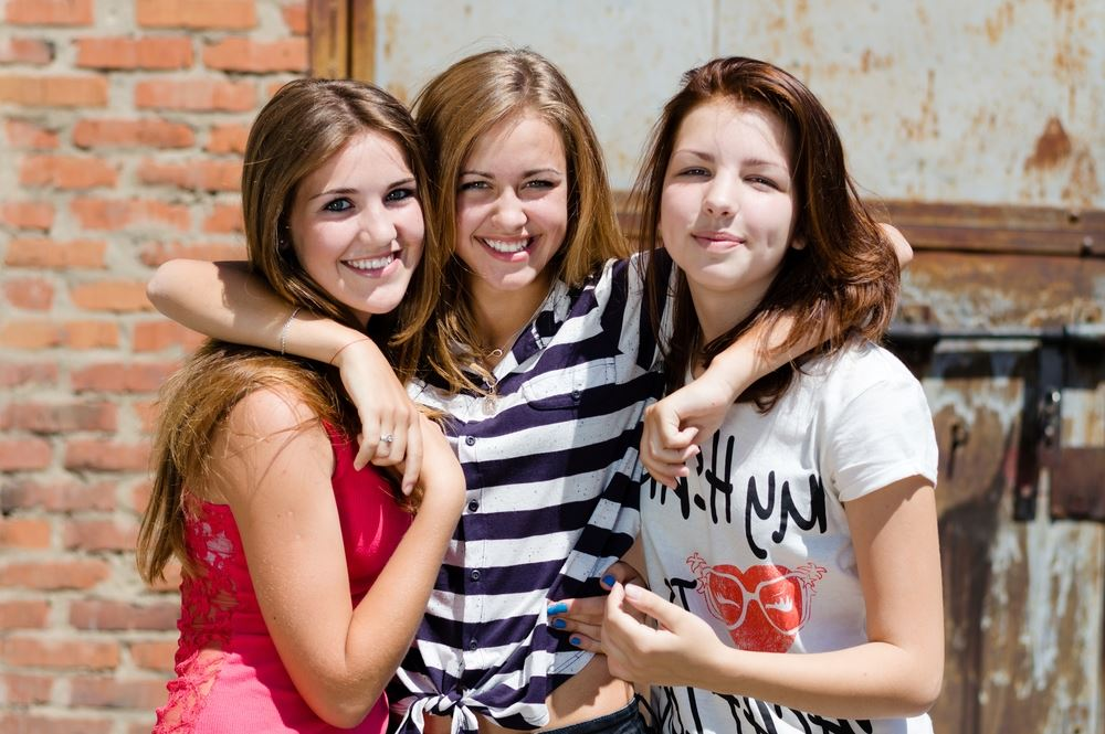 Three young girls smiling