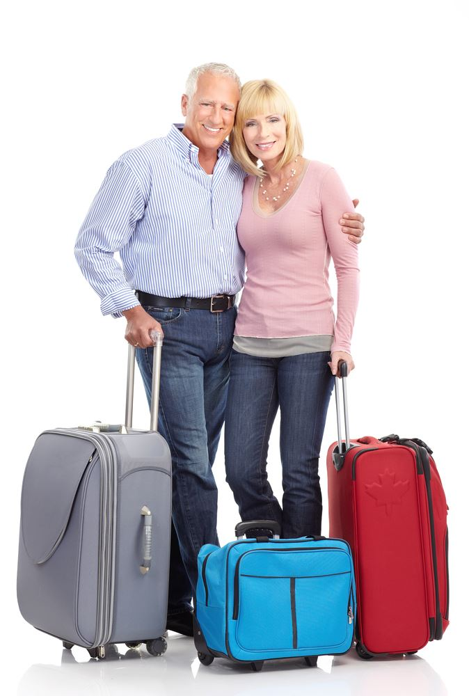 Man and woman with luggage ready for travel