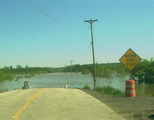 End of the road. Flood water covers Highway 94 near West Alton, Missouri. SCCDEM  photo
