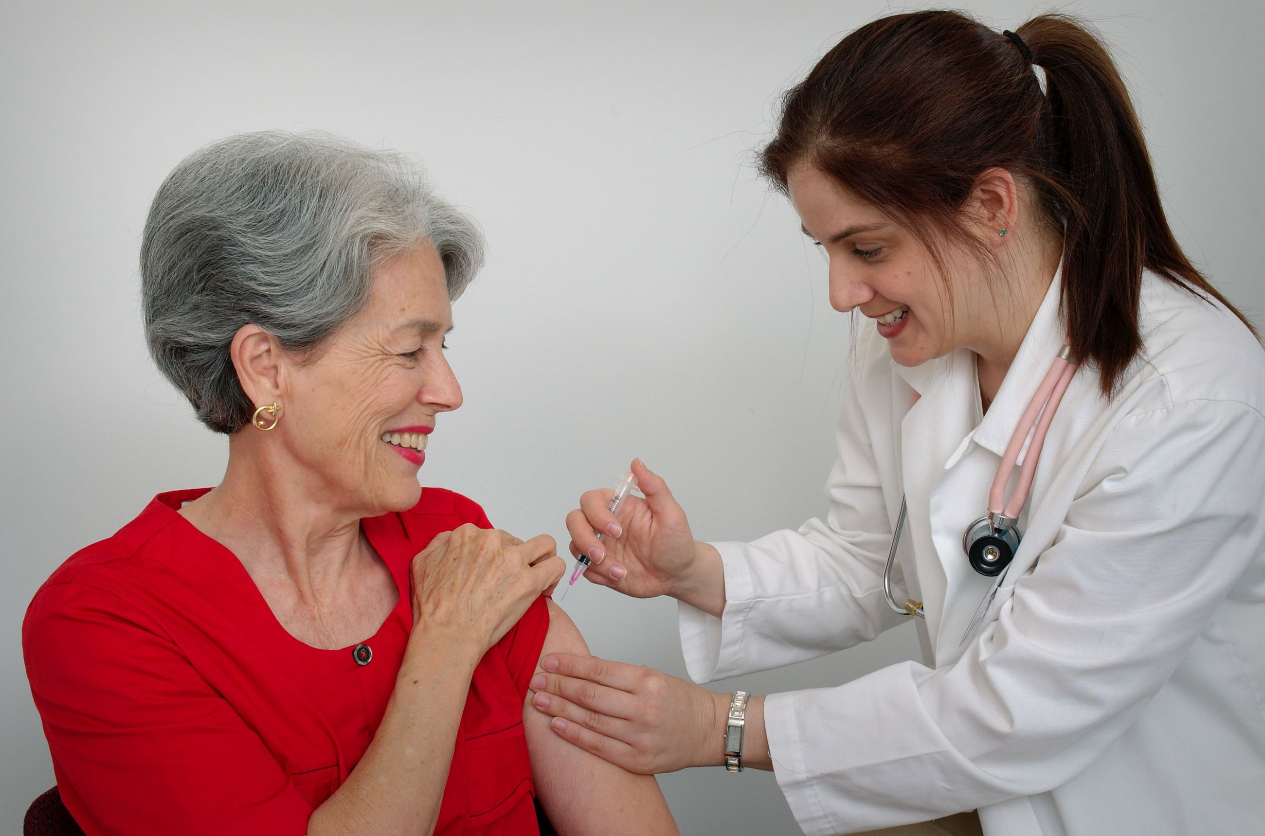 CDC photo of an adult woman receiving a vaccination from a nurse
