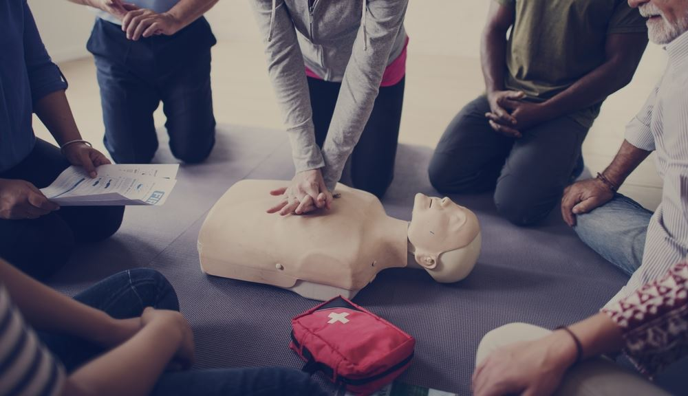 Class demonstrating CPR technique.