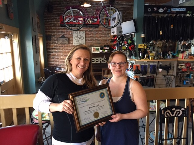 Award presentation to Bike Stop Cafe staff