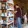 Photo of a family garage with a man and kids storing chemical cleaning products