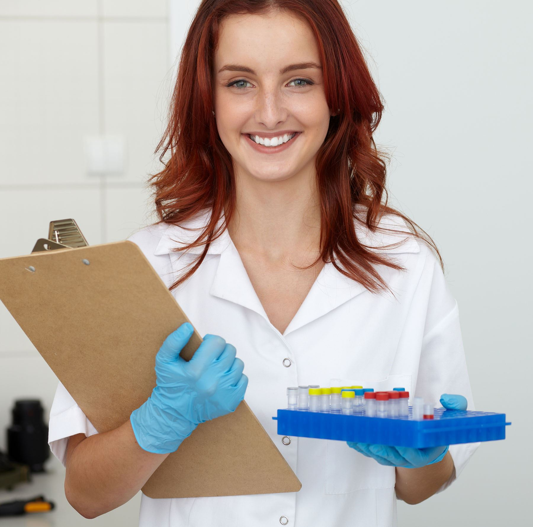 Nurse with specimen vials for testing_crop